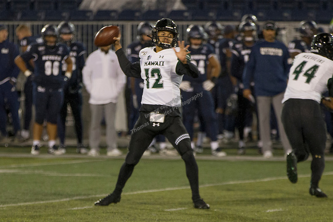 Hawaii quarterback Chevan Cordeiro (12) throws against Nevada in the second half of an NCAA college football game in Reno, Nev. Saturday, Sept. 28, 2019. (AP Photo/Tom R. Smedes)