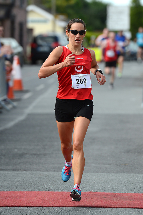 Claire Ryan comes home in the Duleek 10K run. Photo:Colin Bell/pressphotos.ie