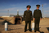 Members of the Russian military pose for a photograph near the flame trench of the Soyuz launch pad at the Baikonur Cosmodrome in Kazakhstan, Friday, Oct. 10, 2008.  The Soyuz TMA-13 spacecraft is scheduled for launch Oct. 12 and will carry Expedition 18 Commander Michael Fincke, Flight Engineer Yury V. Lonchakov and American Spaceflight Participant Richard Garriott to the International Space Station. The three crew members will dock their Soyuz to the International Space Station on Oct. 14. Fincke and Lonchakov will spend six months on the station, while Garriott will return to Earth Oct. 24, 2008 with two of the Expedition 17 crew members currently on the International Space Station. <br /> Mandatory Credit: Bill Ingalls / NASA via CNP