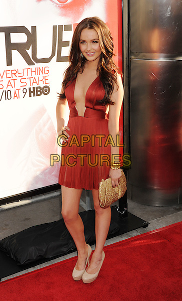Camilla Luddington.'True Blood' Season 5 Los Angeles Premiere at ArcLight Cinemas Cinerama Dome, Hollywood, California, USA..May 30th, 2012.full length red dress plunging neckline hand on hip gold clutch bag.CAP/ROT/TM.© TM/Roth/Capital Pictures