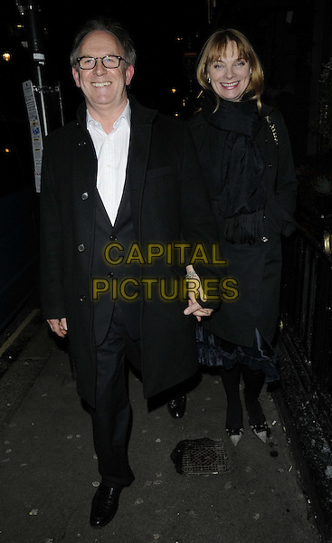 Peter Davison & guest.attended the press night performance of 'Old Times' Harold Pinter Theatre, Panton St., London, England, UK, .January 31st 2013..full length glasses white shirt black coat  scarf holding hands .CAP/CAN.©Can Nguyen/Capital Pictures.