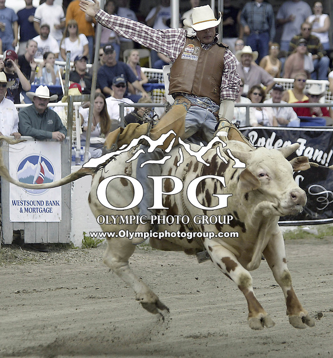 29 Aug 2004: PRCA Rodeo Bull Rider Beau Hill ranked 19th in the world riding the bull Night Vision during the PRCA 2004 Extreme Bulls competition in Bremerton, WA. .