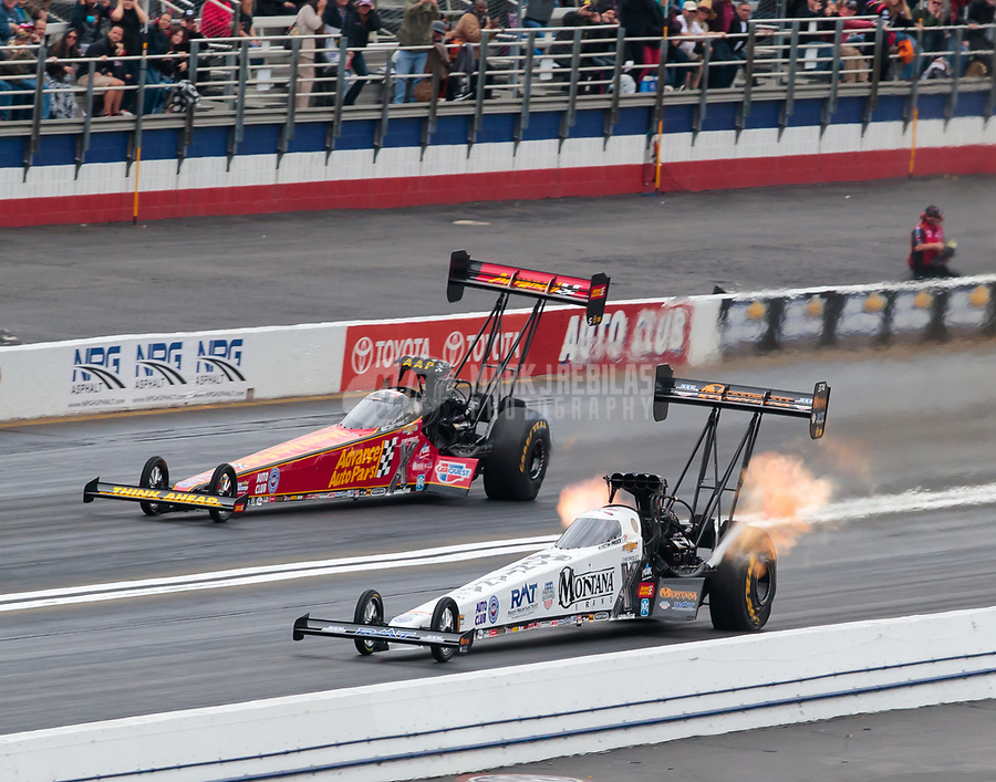 Feb 10, 2019; Pomona, CA, USA; NHRA top fuel driver Austin Prock (near) defeats teammate Brittany Force for the first round win of his NHRA career during the Winternationals at Auto Club Raceway at Pomona. Mandatory Credit: Mark J. Rebilas-USA TODAY Sports