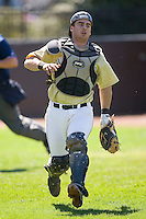 Catcher Michael Murray #15 of the Wake Forest Demon Deacons chases after a foul pop up down the first base line at Jack Coombs Field March 29, 2009 in Durham, North Carolina. (Photo by Brian Westerholt / Four Seam Images)