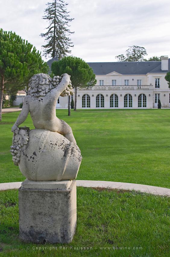 Statue of Bacchus, grape bunch. In the garden. Chateau Malartic Lagraviere, Pessac Leognan, Graves, Bordeaux, France