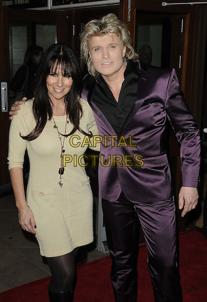 Linda Lusardi & Hans Klok.Hans Klok's 'The Houdini Experience' Press Night at the Peacock Theatre, London, England..February 28th 2012.half 3/4 beige dress necklace length black shirt purple suit  .CAP/CAN.©Can Nguyen/Capital Pictures.