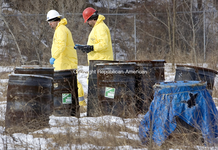 WATERBURY, CT. 24 January 2008-012408SV04--An environmental clean up crew from Cyn Environmental gets ready to remove barrels from a Superfund site on Store Avenue in Waterbury Thursday. The U.S. Environmental Protection Agency was also on scene. The barrels were left over from previous testing on the site.<br /> Steven Valenti Republican-American