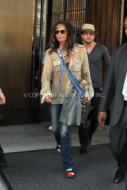 WWW.ACEPIXS.COM....July 24 2012, New york City....Musician Steven Tyler signed autographs for fans as he left a Soho hotel on July 24 2012 in New York City....By Line: Curtis Means/ACE Pictures......ACE Pictures, Inc...tel: 646 769 0430..Email: info@acepixs.com..www.acepixs.com