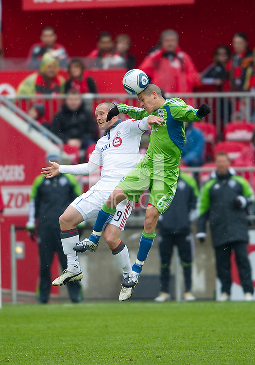 25 April 2010: Seattle Sounders midfielder Osvaldo Alonso #6 and Toronto FC forward Chad Barrett #19 in action during a game between the Seattle Sounders and Toronto FC at BMO Field in Toronto..Toronto FC won 2-0....