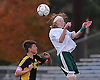 Tommy Browne #10 of Carle Place, right, makes a header during the NYSPHSAA varsity boys soccer Class B Southeast Regional against Hastings at Mitchel Athletic Complex on Saturday, Nov. 5, 2016. Hastings defeated Carle Place by a score of 4-0.