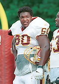 Washington Redskins offensive tackle Chris Samuels (60), the second of two of the team's first round draft pick in the 2000 NFL Draft (third overall pick in the draft), and who played his college football at the University of Alabama, takes a breather between drills during Redskin training camp at Redskin Park in Ashburn, Virginia on July 21, 2000.<br /> Credit: Arnie Sachs / CNP