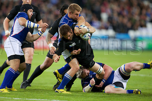 24.09.2015. Olympic Stadium, London, England. Rugby World Cup. New Zealand versus Namibia. New Zealand All Black flanker Richie McCaw is tackled.