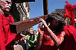 21-year-old Rhody Noura, a Lebanese born in Israel and studying to be priest, re-enacts Jesus' suffering on the Via Dolorosa in Jerusalem's Old City, Friday March 21, 2008. Thousands of Christians from all over the world crowded the stone alleyways to mark Good Friday, retracing the route Jesus took to his crucifixion. Some pilgrims carried large wooden crosses as they walked down the Via Dolorosa, or Way of Sorrows, stopping at 14 stations that commemorate events that befell Jesus as he was led to his death.Photo by: JINI/Daniel Bar-On...