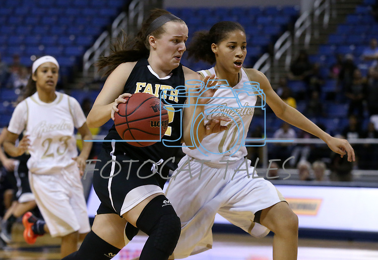 Faith Lutheran's Ellery Wilson drives past Spring Valley's Kayla Harris during the NIAA Division I-A state basketball championship in Reno, Nev. on Saturday, Feb. 27, 2016. Faith Lutheran won 50-47. Cathleen Allison/Las Vegas Review-Journal