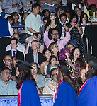 Friends and family members wave to their graduates during the DePaul University College of Computing and Digital Media and the College of Communication hold their commencement ceremony at the Allstate Arena in Rosemont, IL. (DePaul University/Jamie Moncrief)