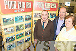 DISPLAY: Inspecting the new display of photographs of Puck Fair from 1959 at Killorglin Library this week were l-r: Pa Houlihan, Denis O'Neill and Margaret Riordan (Librarian).