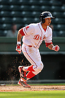 Infielder Mookie Betts (7) of the Greenville Drive bats in a game against the Delmarva Shorebirds on Monday, April 29, 2013, at Fluor Field at the West End in Greenville, South Carolina. Betts was selected by the Boston Red Sox in the 5th Round of the 2011 First-Year Player Draft. Delmarva won, 6-5 in game one of a doubleheader. (Tom Priddy/Four Seam Images)