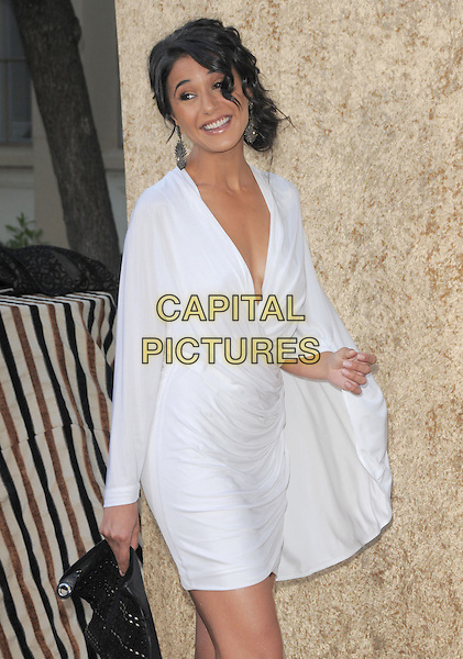 EMMANUELLE CHRIQUI.at the HBP Premiere of The 7th Season of Entourage held at Paramount Picture Studios in Hollywood, California, USA, June 16th 2010..Half length white kimono sleeve dress                                                 low cut plunging necklace clutch bag black.CAP/RKE/DVS.©DVS/RockinExposures/Capital Pictures.