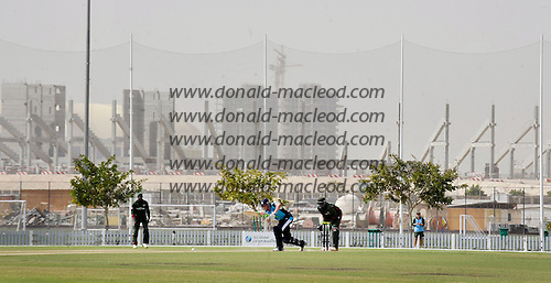 T20 World Cup Qualifying match - Scotland V Kenya at ICC Glabal Cricket Academy - Dubai - against a backdrop of the building site that Dubai appears to be Scotland's Calum MacLeod hits out to top score on 55 setting the base for a 14 run victory in the game and collecting the Man of the Match award - Picture by Donald MacLeod  13.3.12  07702 319 738  clanmacleod@btinternet.com