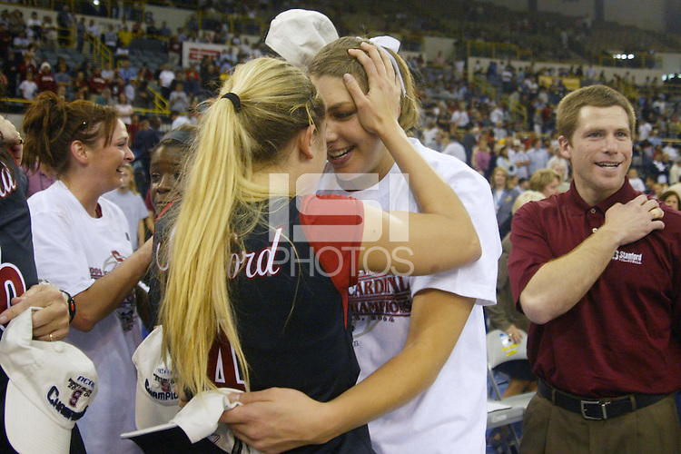 18 December 2004: Stanford Cardinal Liz Suiter with Courtney Schultz during Stanford's  30-23, 30-27, 30-21 victory over Minnesota in the 2004 NCAA Women's Volleyball National Championships in Long Beach, CA. Stanford won their sixth women's volleyball title in school history.<br />