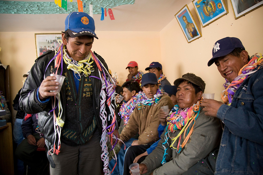Miner's celebrating in the office of the mining cooperative during the miner's carnaval.