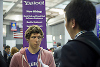Engineers and applied science students at the Yahoo job booth at the NYU-Poly Engineering and Technology Spring Career Fair at NYU-Poly in Brooklyn in in New York on February 28, 2013.  The US Labor Department reports new claims for unemployment benefits for last week dropped 22,000 to a seasonally adjusted 344,000.   © Frances M. Roberts)