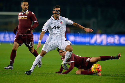 28.11.2015. Stadio Olimpico, Torino, Italy. Serie A. Torino versus Bologna. Giuseppe Vives vies for the ball with Domenico Maietta. Torino ran out 2-0 winners.