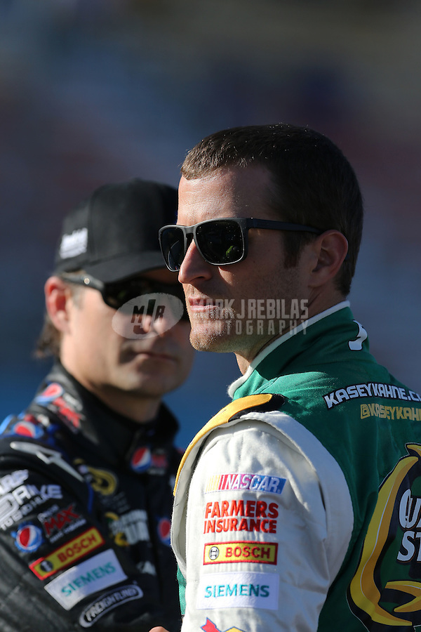 Mar. 1, 2013; Avondale, AZ, USA; NASCAR Sprint Cup Series driver Kasey Kahne (right) and teammate Jeff Gordon during qualifying for the Subway Fresh Fit 500 at Phoenix International Raceway. Mandatory Credit: Mark J. Rebilas-