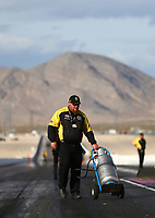 Oct 29, 2016; Las Vegas, NV, USA; NHRA safety safari official does track prep during qualifying for the Toyota Nationals at The Strip at Las Vegas Motor Speedway. Mandatory Credit: Mark J. Rebilas-USA TODAY Sports