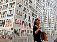 A girl is walking in the SOHO area. SOHO area is a new development of small offices, meant to attract small businesses in the Central Business District (CBD) of Beijing, China. .16 Sep 05