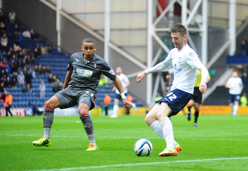 Preston North End's Paul Gallagher vies for possession with Rotherham United's James Tavernier <br /> <br /> Photographer Chris Vaughan/CameraSport<br /> <br /> Football - The Football League Sky Bet League One Play-Off First Leg - Preston North End v Rotherham United - Saturday 10th May 2014 - Deepdale - Preston<br /> <br /> &copy; CameraSport - 43 Linden Ave. Countesthorpe. Leicester. England. LE8 5PG - Tel: +44 (0) 116 277 4147 - admin@camerasport.com - www.camerasport.com