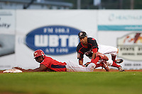 Batavia Muckdogs second baseman Giovanny Alfonzo (8) attempts to tag Josh Tobias (33) sliding into second during a game against the Williamsport Crosscutters on August 29, 2015 at Dwyer Stadium in Batavia, New York.  Williamsport defeated Batavia 7-3.  (Mike Janes/Four Seam Images)