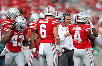 Ohio State Buckeyes head coach Urban Meyer speaks to his players in the second quarter of the college football game between the Ohio State Buckeyes and the Northern Illinois Huskies at Ohio Stadium in Columbus, Saturday afternoon, September 19, 2015. As of half time the Ohio State Buckeyes were tied with the Northern Illinois Huskies 10 - 10. (The Columbus Dispatch / Eamon Queeney)