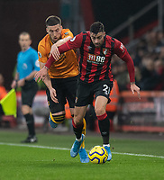Bournemouth's Diego Rico (right) is tackled by Wolverhampton Wanderers' Matt Doherty (left) <br /> <br /> Photographer David Horton/CameraSport<br /> <br /> The Premier League - Bournemouth v Wolverhampton Wanderers - Saturday 23rd November 2019 - Vitality Stadium - Bournemouth<br /> <br /> World Copyright © 2019 CameraSport. All rights reserved. 43 Linden Ave. Countesthorpe. Leicester. England. LE8 5PG - Tel: +44 (0) 116 277 4147 - admin@camerasport.com - www.camerasport.com