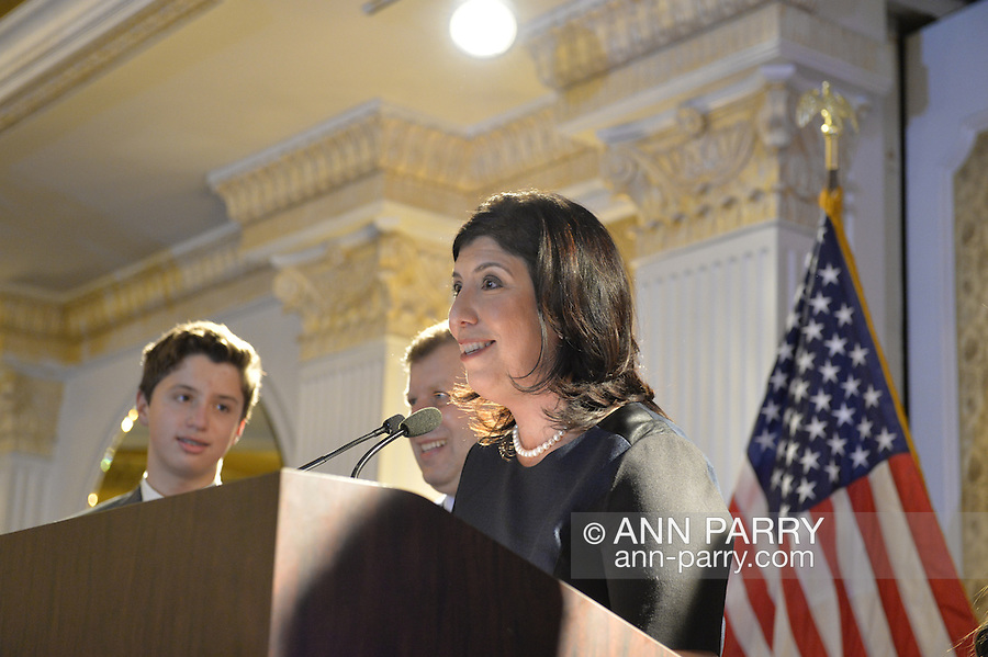 Garden City, New York, USA. 3rd November 2015. Democrat MADELINE SINGAS claims victory over Republican Kate Murray in the hotly contested race for Nassau County District Attorney. Singas, the Acting District Attorney, took the podium at the Nassau County Democrats Election Night Party at the Garden City Hotel, to thank her supporters, when, with more than 99% of the precincts results in, she was comfortably leading Murray, who's Hempstead Town Supervisor. Singas's family joined her on stage.