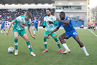 Frank Nouble of Colchester United flicks the ball between  Byron Moore of Plymouth Argyle and Scott Wootton of Plymouth Argyle during Colchester United vs Plymouth Argyle, Sky Bet EFL League 2 Football at the JobServe Community Stadium on 8th February 2020