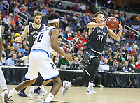 Washington, DC - March 11, 2018: Davidson Wildcats guard Kellan Grady (31) passes the ball during the Atlantic 10 championship game between Rhode Island and Davidson at  Capital One Arena in Washington, DC.   (Photo by Elliott Brown/Media Images International)
