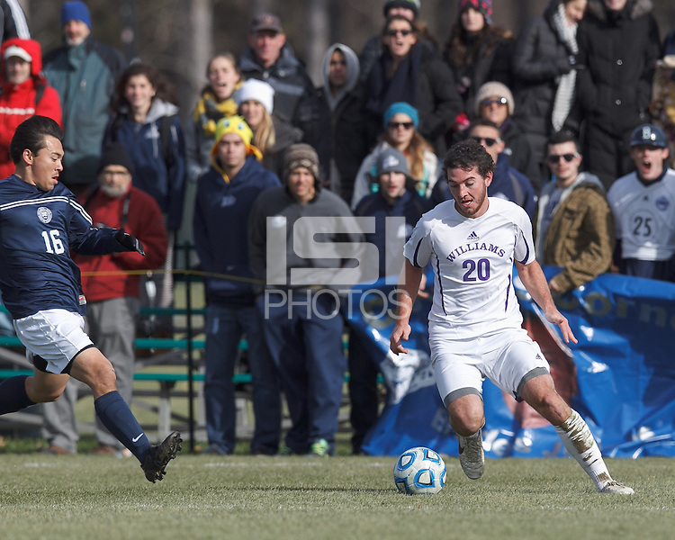 Williams forward Matt Kastner (20) dribbles as Brandeis defender Josh Hacunda (16) closes. NCAA Division III Sectionals. Williams College (white) defeated Brandeis University (blue/white), 2-0, on Hitchcock Field at Amherst College on November 23, 2013.