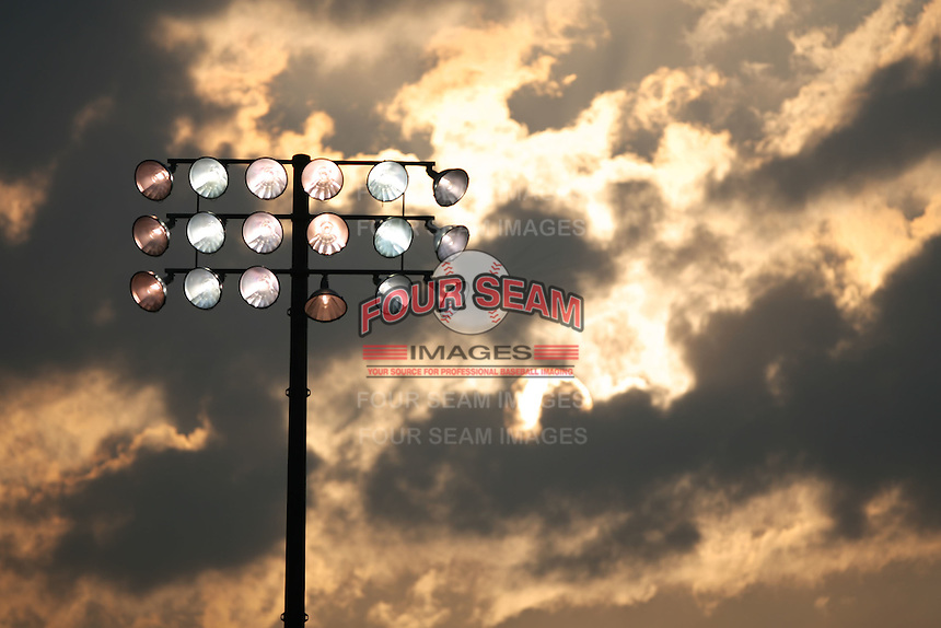 August 4th 2007:  The lights of Dwyer Stadium start up as the sun goes down in Batavia, NY.  Photo by Mike Janes/Four Seam Images