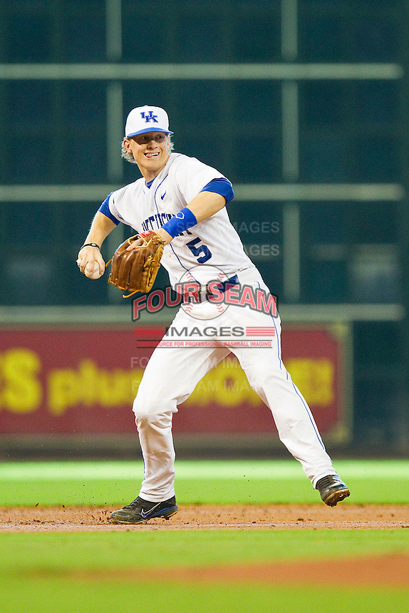 Shortstop Taylor Black #5 of the Kentucky Wildcats makes a throw to first base against the Houston Cougars at Minute Maid Park on March 5, 2011 in Houston, Texas.  Photo by Brian Westerholt / Four Seam Images