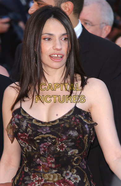 "BEATRICE DALLE.Screening of ""The Ladykillers"", Cannes Film Festival, France, 18th May 2004..half length black ruffle dress with floral print.Ref: PL.www.capitalpictures.com.sales@capitalpictures.com.©Capital Pictures"
