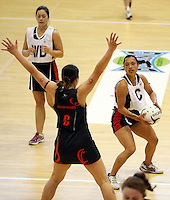 29.09.2014 Counties Manukau's Leatiana Shelford in action during the  Counties Manukau v Eastern Waikato duing the Lion Foundation Netball Champs at the Trusts Stadium in Auckland. Mandatory Photo Credit ©Michael Bradley.