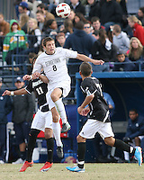 Tommy Muller #8 of Georgetown University heads over Giuseppe Guerriero #11 of Providence University during a Big East quarter-final  match at North Kehoe Field, Georgetown University on November 6 2010 in Washington D.C. Providence won 2-1.