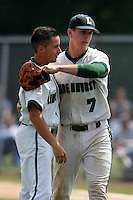 June 12, 2010:  Lindenhurst first baseman Jon McGibbon (7) celebrates with a teammate vs Valley Central during the NYSPHAA Class-AA State Championship semi-final game at Binghamton University in Binghamton, NY.  McGibbon was seleced in the 29th round by the Seattle Mariners of the 2010 MLB draft but chose to attend Clemson University to play for the Bulldogs.  Photo By Mike Janes/Four Seam Images