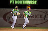 Eugene Emeralds outfielders Jonathan Sierra (22) and D.J. Artis (34) jog off the field after a Northwest League game against the Salem-Keizer Volcanoes at Volcanoes Stadium on August 31, 2018 in Keizer, Oregon. The Eugene Emeralds defeated the Salem-Keizer Volcanoes by a score of 7-3. (Zachary Lucy/Four Seam Images)