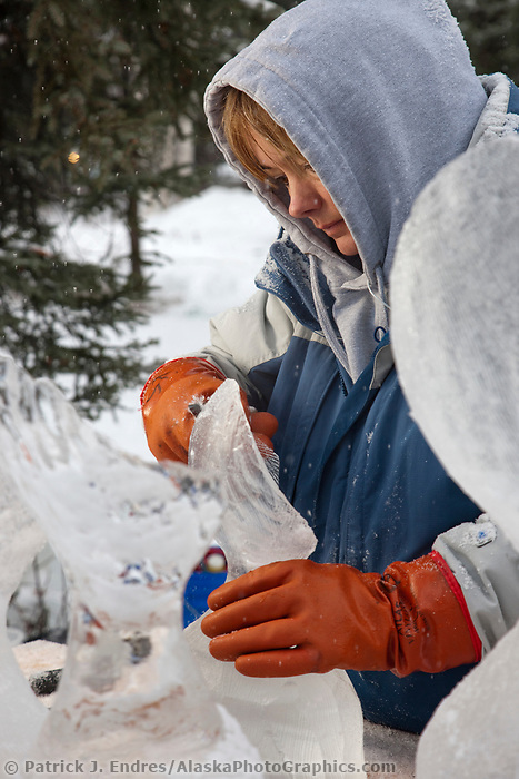 "Alaska sculptor Kristi Stewart, carves away on a single block, abstract sculpture titled ""It is what it is"" during the 2009 World Ice Art Championships in Fairbanks, Alaska."