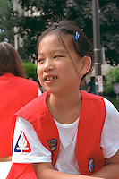 Campfire girl age 7 smiling on Grand Old Day parade float.  St Paul  Minnesota USA