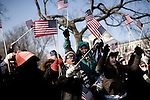 January 20, 2009. Washington, DC..Almost 2 million people packed the National Mall in sub freezing temperatures to witness the swearing in of Barack Obama, the 44th president of the united States and the first African American to hold the office.  .The crowd went wild at the beginning of the ceremonies after hours of cold waiting. Leola Jackswife, center, of DC, was overjoyed as the new president was sworn in.