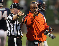Virginia Cavaliers head coach Mike London argues with an official during the game at Scott Stadium. Virginia was defeated 30-24. (Photo/Andrew Shurtleff)