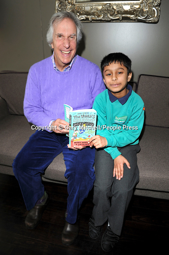 Milton Keynes, UK -  Actor and dyslexic author Henry Winkler - aka 'The Fonz' - meets children from local schools in Milton Keynes. .Henry is touring schools and theatres with Nicky Cox, editor of children's newspaper First News as part of the '2013 First News My Way' campaign, in partnership with Charity, Achievement for All 3As. .Pictured - Henry Winkler with Yash Tailor, Milton Keynes Theatre, Bucks, UK - 8th March 2013..Photo by Gary Mitchell